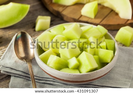 Green Organic Honeydew Melon Cut in a Bowl - stock photo