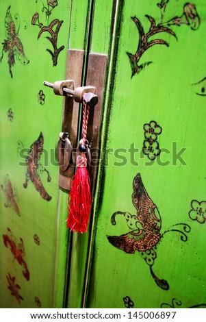 Green oriental-style door - stock photo
