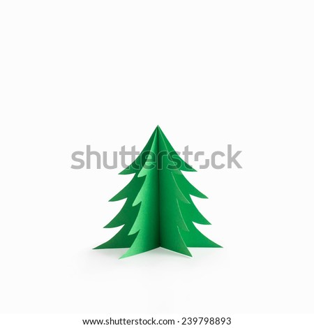 Green origami christmas tree paper craft isolated on white background - stock photo