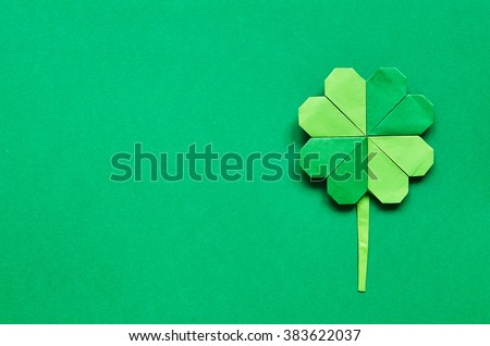 Green origami shamrock clover leaf paper background. St. Patrick's Day greeting postcard template. Space for copy, text, lettering. - stock photo