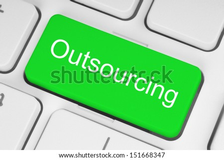 Green outsourcing button on white keyboard  - stock photo