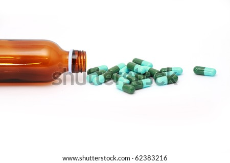 Green oval pills with dose on white background. - stock photo