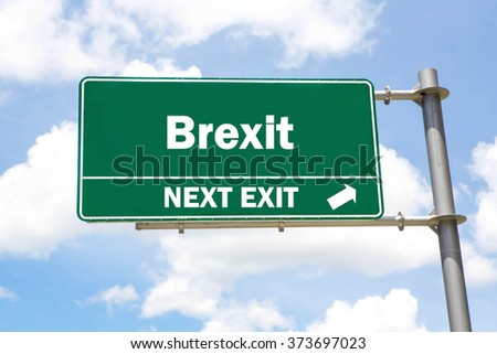 Green overhead road sign with a Brexit Next Exit concept against a partly cloudy sky background. - stock photo