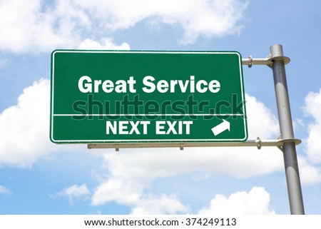 Green overhead road sign with a Great Service Next Exit concept against a partly cloudy sky background. - stock photo