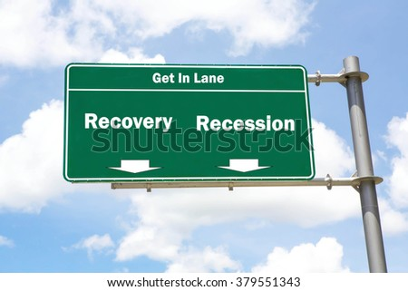 Green overhead road sign with the instruction to get in lane with a Recovery or Recession concept against a partly cloudy sky background. - stock photo