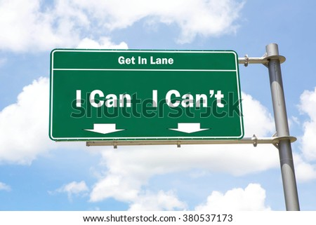 Green overhead road sign with the instruction to get in lane with an I Can Or I Can't concept against a partly cloudy sky background. - stock photo