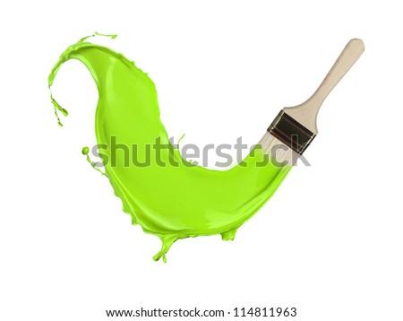 Green paint splashing out of brush. Isolated on white background - stock photo