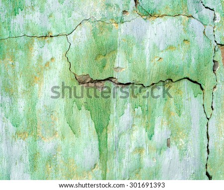 Green painted damaged grunge wall background or texture - stock photo