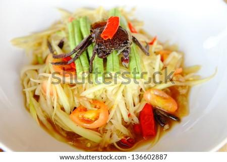 Green papaya salad (somtam) , famous Thai food. Very spicy! - stock photo