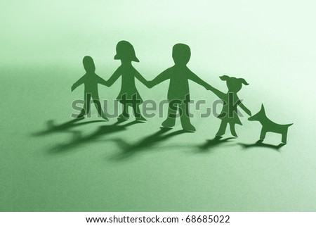 green paper family with dog - stock photo