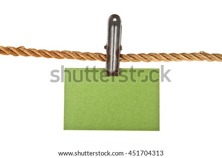green paper on a rope isolated on white background closeup - stock photo
