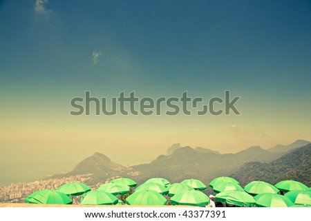 green parasols at Corcovado overlooking Ipanema - stock photo