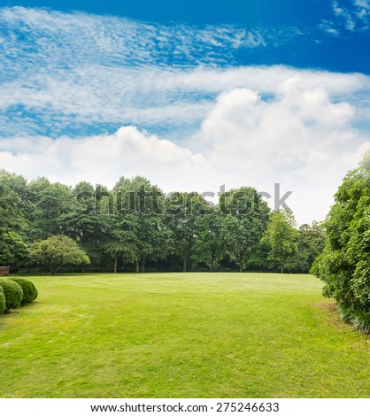 Green park with blue sky - stock photo