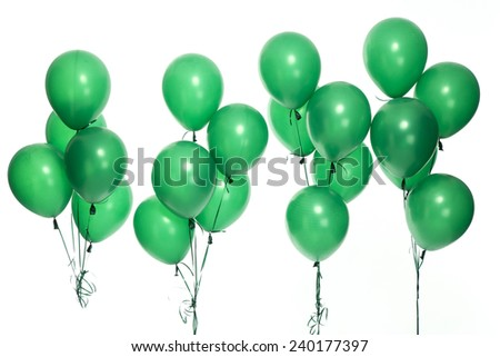 Green party balloons on the white background. - stock photo