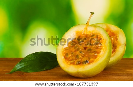 green passion fruit on bright green background close-up - stock photo