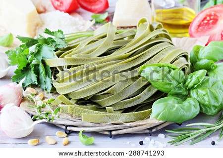 Green pasta, vegetables and herbs.Traditional Italian food . - stock photo