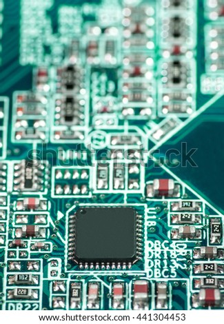 green pcb motherboard chip microchip integrated circuit board pattern background - stock photo