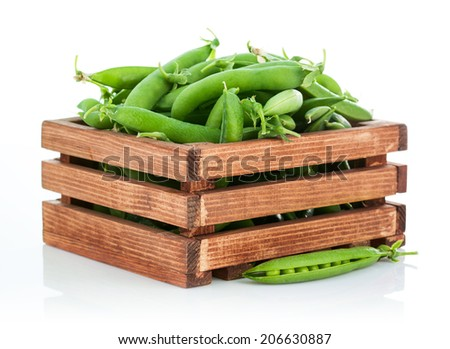 Green peas in wooden box. Isolated on white background - stock photo