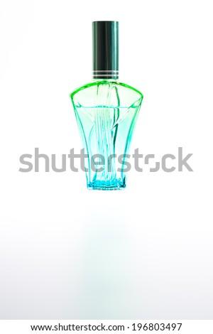 Green Perfume Bottle in isolate - stock photo