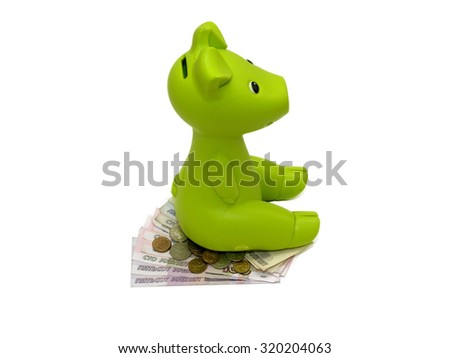 Green piggy bank or money box  isolated on white with Clipping Path. - stock photo