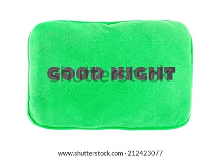 Green pillow with text isolated on white background. - stock photo