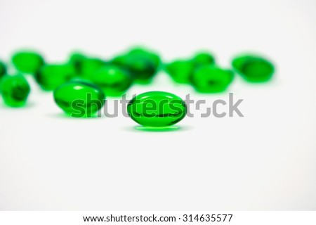 green pills soft gel capsule isolated on white background - stock photo