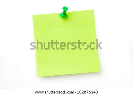 Green pinned adhesive note against a white background - stock photo