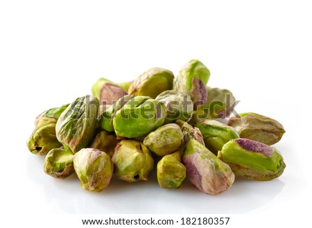 green pistachios isolated on a white background - stock photo