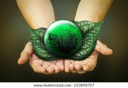 Green planet in  hands - stock photo