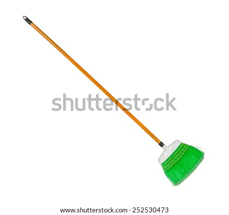 Green plastic broom with log brown handle isolated over white - stock photo