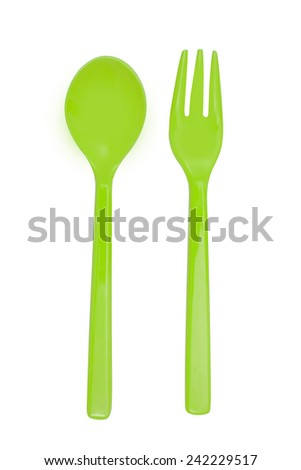 Green plastic  fork and spoon isolated on white - stock photo