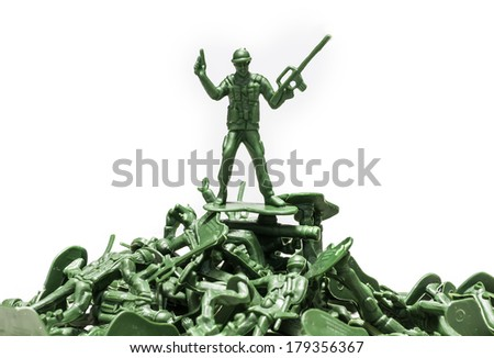 Green plastic soldiers on white background victorious in battle - stock photo