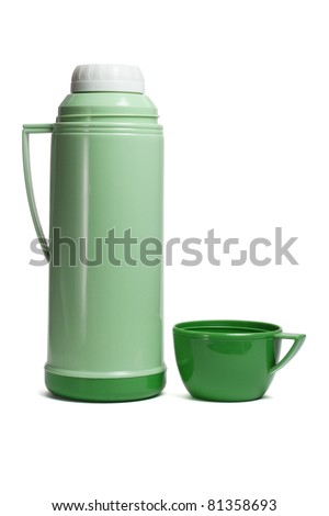 Green plastic thermos flask with cup on white background - stock photo