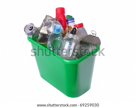 Green plastic trash bin filled with assorted domestic garbage - isolated on white background - stock photo