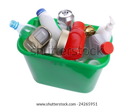 Green plastic trash bin filled with assorted domestic garbage - over white background - stock photo