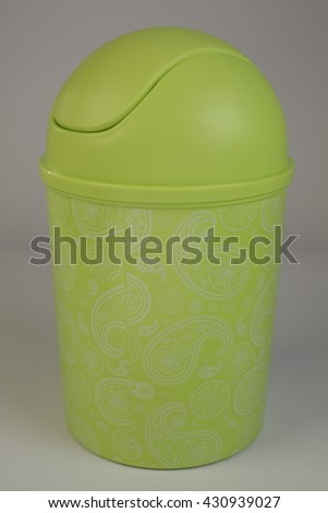 green plastic trash can - stock photo