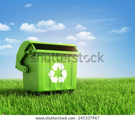 Green plastic trash recycling container ecology concept, with landscape background. - stock photo