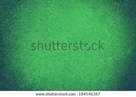 Green poker table felt background. Toned image - stock photo