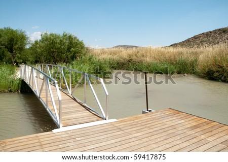 green pond and dock at Rio Grande Village - stock photo