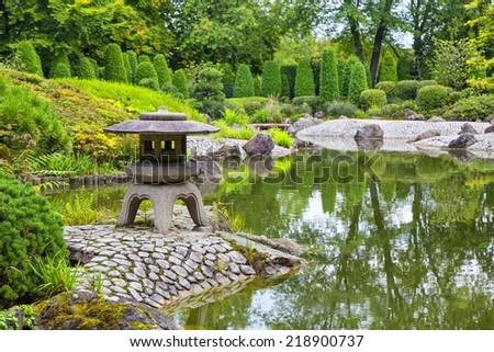 Green pond in Japanese garden in Bonn, Germany - stock photo