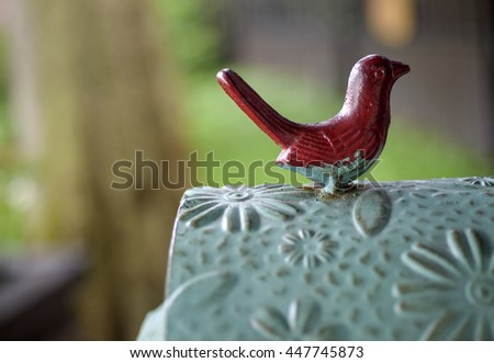 Green post mail letter box with red bird - stock photo