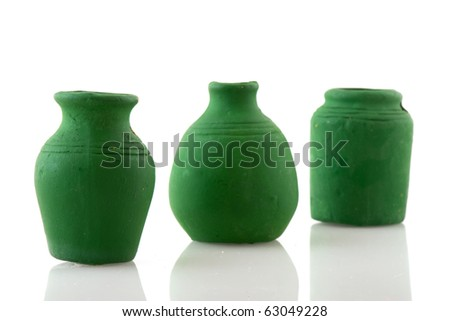 Green pottery jars in a row isolated over white - stock photo