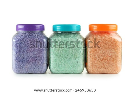 Green, purple, orange sea salt in bottles isolated on white - stock photo
