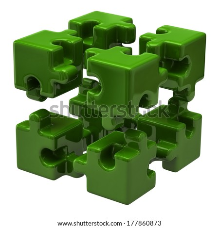 Green puzzle cube isolated on white background - stock photo