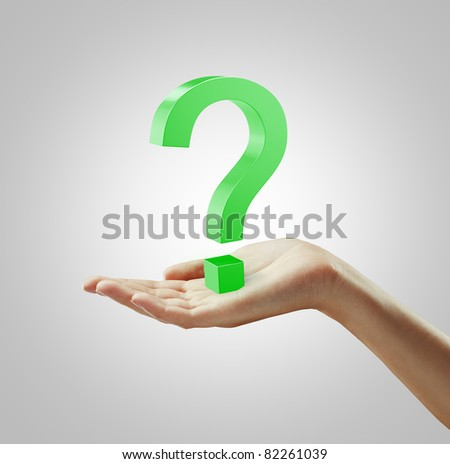 Green question mark on a woman's hand - stock photo