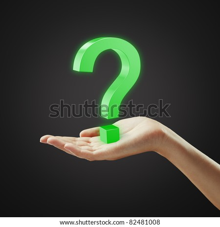 Green question mark on a woman's hand.Isolated on a black background - stock photo
