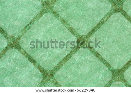 Green recyclable air filter  for conditioner or heat pump back side; close up - stock photo