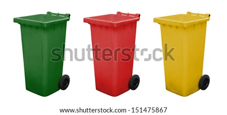 Green red and yellow garbage bins - stock photo