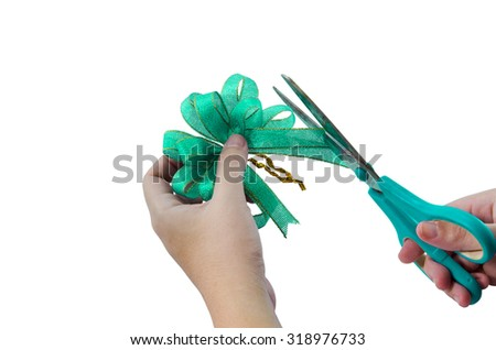 Green ribbon cutting isolated on white background - stock photo