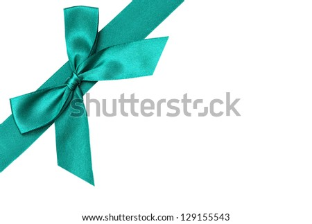 Green ribbon over white paper - stock photo
